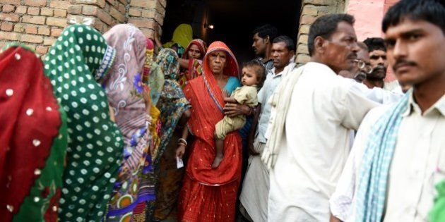 An Indian voter leaves after casting her ballot in the village of Banbira in Samstipur district on October...