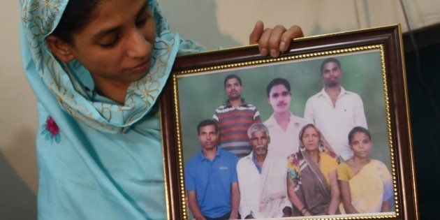 Indian woman, Geeta holds a photograph, possibly of her family, at the Edhi Foundation in Karachi on...