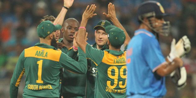 South African players celebrate the wicket of India's Axar Patel, during the final one-day international...