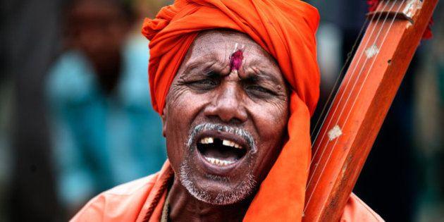 Devotee of God Vitthal is singing praises of God,