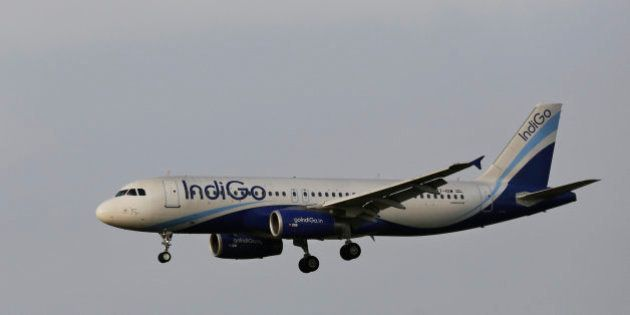 In this Thursday, April 16, 2015 photo, India's budget airline IndiGo approaches for landing at the Indira...