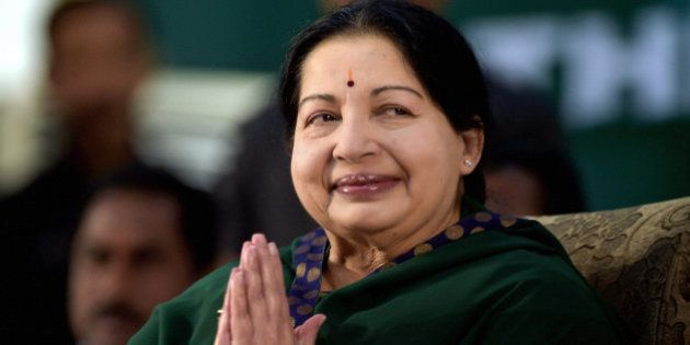 AIADMK leader Jayaram Jayalalitha greets the audience during her swearing-in-ceremony as the Chief Minister...