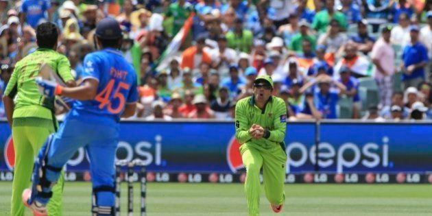 Pakistan captain Misbah-ul-Haq, takes a catch to dismiss India's Rohit Sharma during the World Cup Pool...