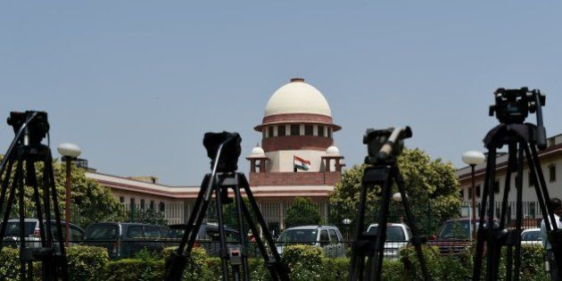 Camera tripods are lined up outside the Supreme court during the judgement on 'Santhara' in New Delhi...