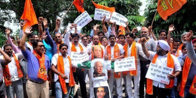 NEW DELHI, INDIA - 2015/08/22: Hindu right-wing Shiv Sena activists burn an effigy and pictures of Pakistani...