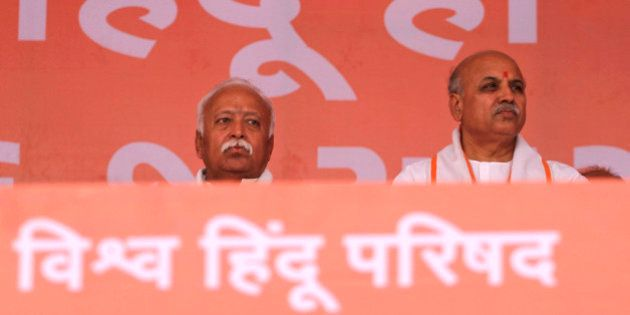 Indian Hindu leader Pravin Togadiya, right, and Rashtriya Swayamsevak Sangh head Mohan Bhagwat attend...