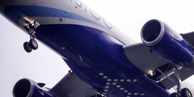 A logo sits on the underside of the fuselage of an Airbus SAS A320 aircraft operated by IndiGo, owned...