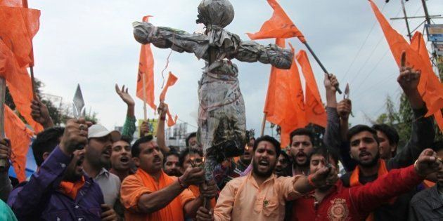 India's Hindu right-wing Shiv Sena activists prepare to burn an effigy of Kashmiri separatist Masarat...