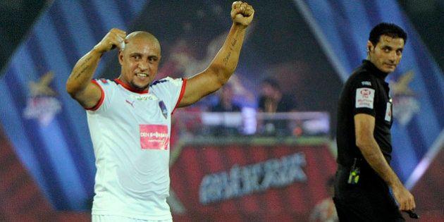 KOLKATA, INDIA - OCTOBER 29: Roberto Carlos of Delhi Dynamos FC in action against Atletico De Kolkata...