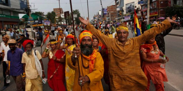 Hindu activists and Shiv Sena Nepal hold tridents as they take out a rally demanding that Nepal be declared...