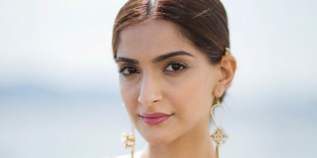 Actress Sonam Kapoor poses for a photograph during the 68th international film festival, Cannes, southern...
