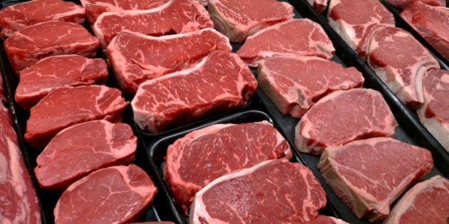 FILE - In this Jan. 18, 2010 file photo, steaks and other beef products are displayed for sale at a grocery...