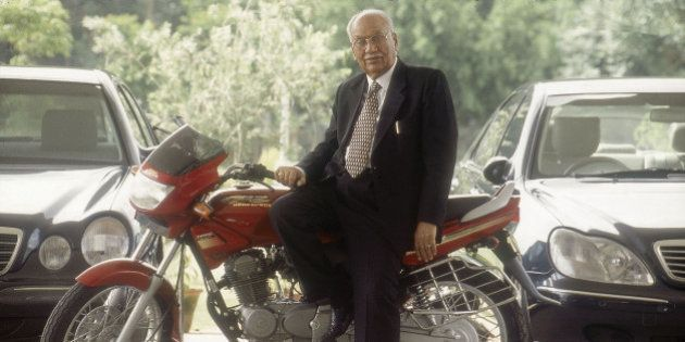 INDIA - AUGUST 22: Brijmohan Lall Munjal, Chairman, Hero Honda Motors Ltd sitting on his motorcycle (...