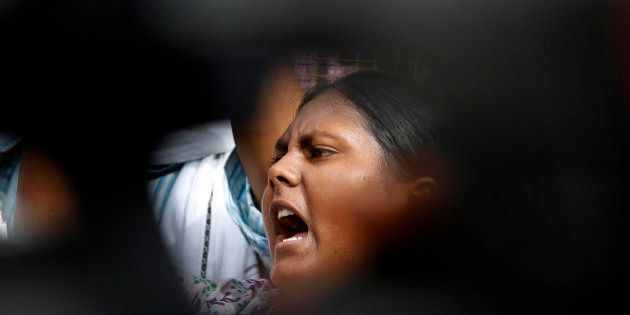 A member of Jawaharlal Nehru University Students Union shouts slogans during a protest against a gang...