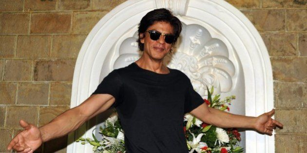 Indian Bollywood actor Shah Rukh Khan poses for a photograph during a photocall for his 49th birthday...