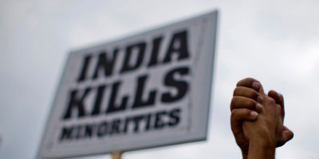A group of demonstrators organized by the human rights group Sikhs for Justice protest outside the White...