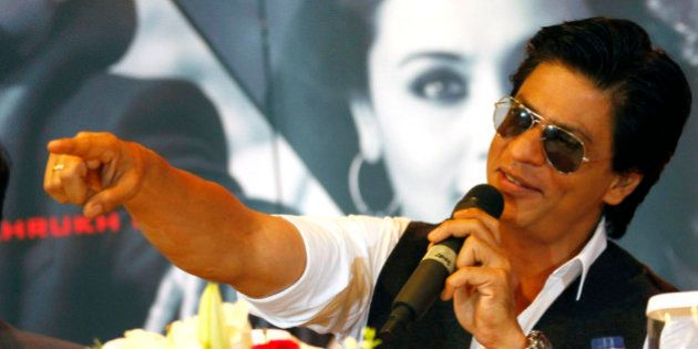 Bollywood actor Shah Rukh Khan gestures during a press conference ahead of