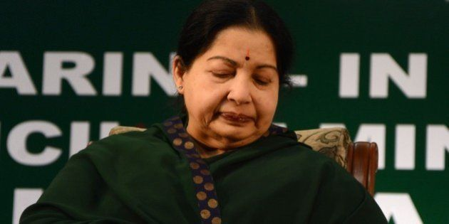 Chief of the All India Anna Dravida Munnetra Kazhagam (AIADMK) party Jayalalithaa Jayaram looks at her...