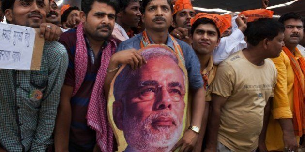 Supporters of India's main opposition and Hindu nationalist Bharatiya Janata Party (BJP) prime ministerial...