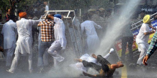 CHANDIGARH, INDIA - OCTOBER 21: Police using the water cannon to spot Simarjit Singh Bains, Independent...