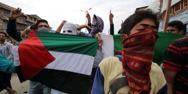 SRINAGAR, KASHMIR, INDIA - JULY 17: Kashmiri muslim protesters shout slogans in support of Palestine...
