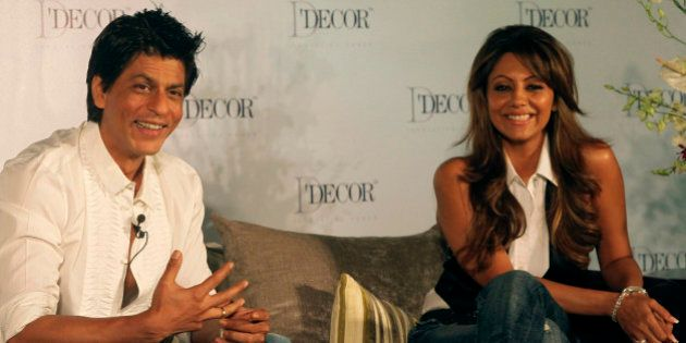 Bollywood actor Shah Rukh Khan, left, and his wife Gauri Khan look on during an event in Mumbai, India,...
