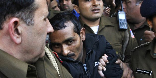 NEW DELHI, INDIA DECEMBER 8: Police escort Uber cab driver Shiv Kumar Yadav (C, in black) who is accused...