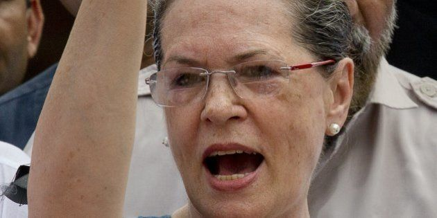 India's opposition Congress party president Sonia Gandhi shouts slogans against the government during...