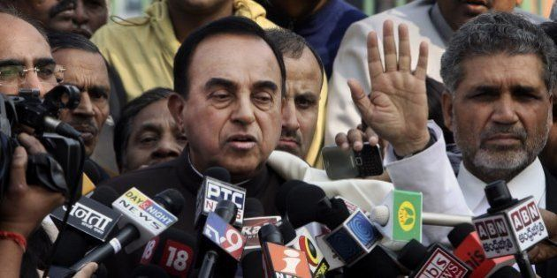India's opposition lawmaker Subramanian Swamy speaks to the media outside the Supreme Court in New Delhi,...