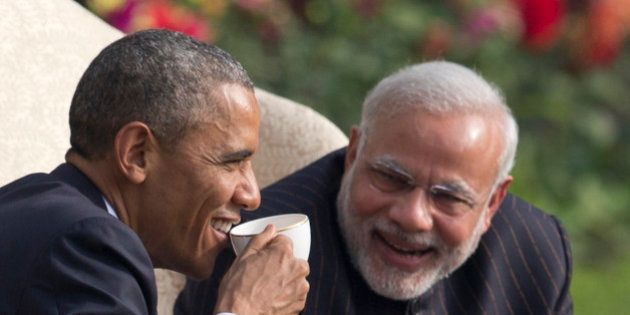 President Barack Obama and Indian Prime Minister Narendra Modi have coffee and tea in the gardens of...
