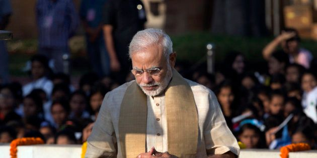Indian Prime Minister Narendra Modi pays tributes at the memorial of Mahatma Gandhi on the occasion of...