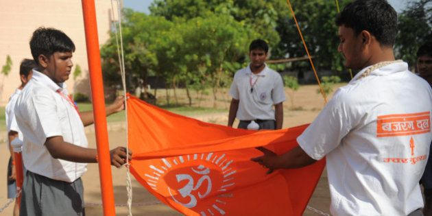 Senior Bajrang Dal volunteers fold with respect the Bajrand Dal Flag at a youth camp on the outskirts...