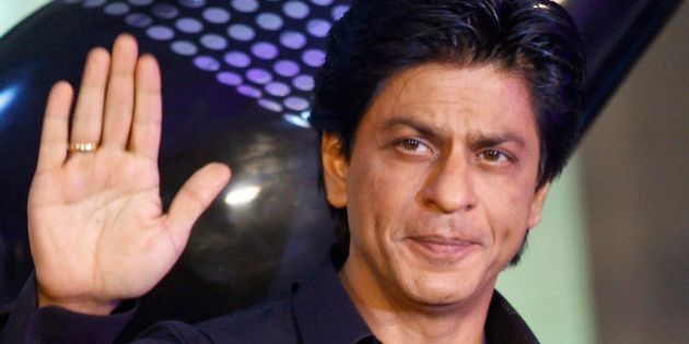 FILE - In this Jan. 29, 2013 file photo, Bollywood actor Shah Rukh Khan waves during the unveiling of...