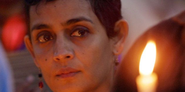 Arundhati Roy, winner of Booker Prize, Britain's most prestigious literature award, attends a candlelight...