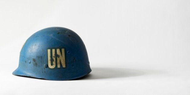 United Nations blue peacekeeper's helmet with the initials UN on