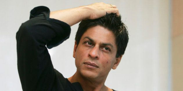 Bollywood actor Shah Rukh Khan gestures during an interview with The Associated Press at his residence...