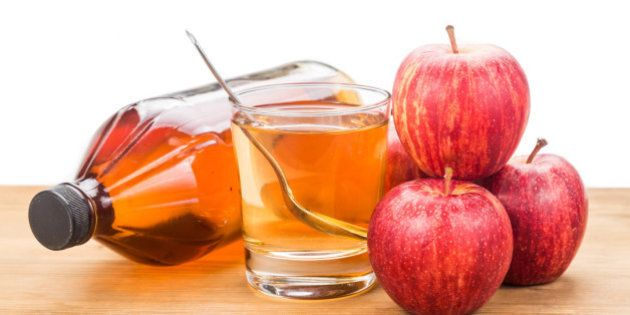 Apple cider vinegar in jar, glass and fresh apple, healthy