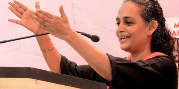 Indian author and poltical activist Arundhati Roy gestures as she addresses activists from The Popular...