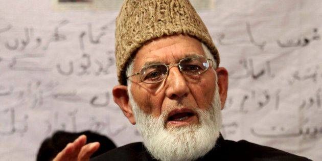 Pro-Pakistan separatist leader Syed Ali Shah Geelani addresses a press conference in Srinagar, India,...
