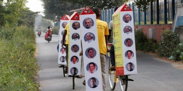 PATNA, INDIA - OCTOBER 19: Supporters of JD(U) on their cycle-raths carrying publicity material during election campaigning for Chief Minister of Bihar Nitish Kumar amid Bihar Assembly Elections, at Phulwari Sharif on October 19, 2015 in Patna, India. Bihar will hold five-phase elections between October 12 and November 5 to elect the 243-member assembly. Counting of votes will take place on November 8. (Photo by Arvind Yadav/Hindustan Times via Getty Images)