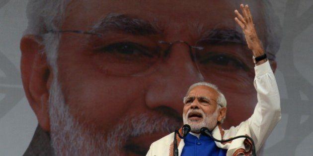 Indian Prime Minister Narinder Modi addresses a public rally in Srinagar on November 7, 2015. Prime Minister...