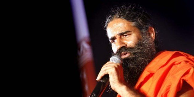 NEW DELHI, INDIA - OCTOBER 9: Yoga Guru Baba Ramdev addresses during a press conference on October 9,...