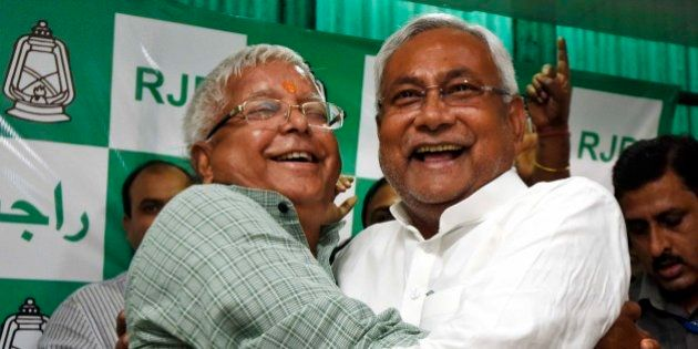 PATNA, INDIA - NOVEMBER 8: RJD Chief Lalu Prasad Yadav and Nitish Kumar celebrate after Mahagathbandhan's...