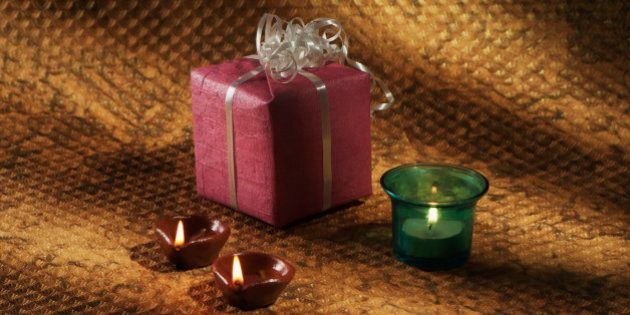 Gift, candle and oil lamps on