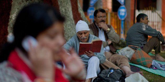 SRINAGAR, KASHMIR, INDIA - MAY 26: An elderly Kashmiri Pandit (Hindu) devotee recites Holy Bagavad Gita...