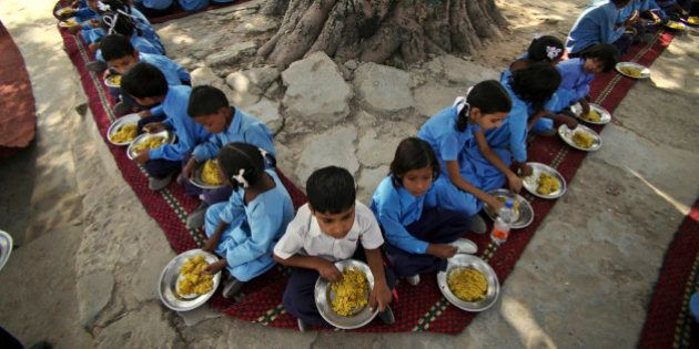 Indian schoolchildren eat a free midday meal, provided on all working days at a government school on...