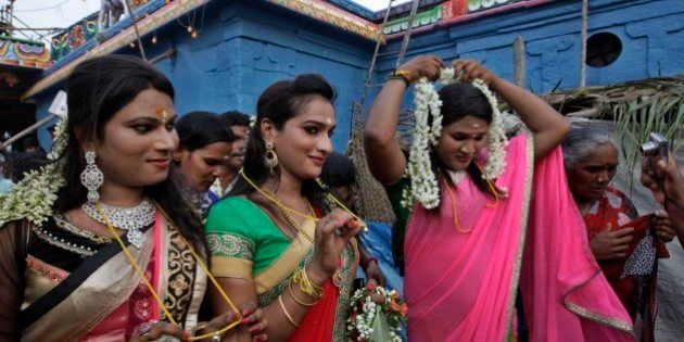 Indian eunuchs show their holy strings after the marriage ceremony during the annual eunuch festival...