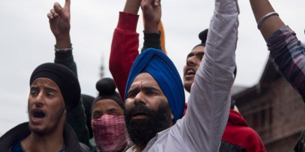 Sikhs shout slogans against Indian security forces during a protest in Srinagar, Friday, June 5, 2015....