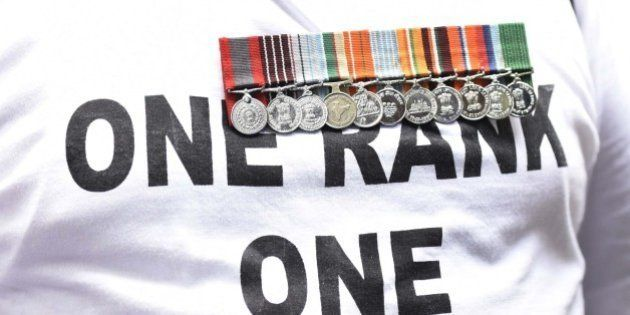 NEW DELHI, INDIA - AUGUST 23: A Retired army man with medals hanging on his chest during One Rank One...
