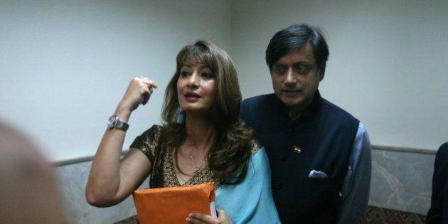 MUMBAI, INDIA - AUGUST 6: (File photo) Indian politician Shashi Tharoor with his wife Sunanda Pushkar...